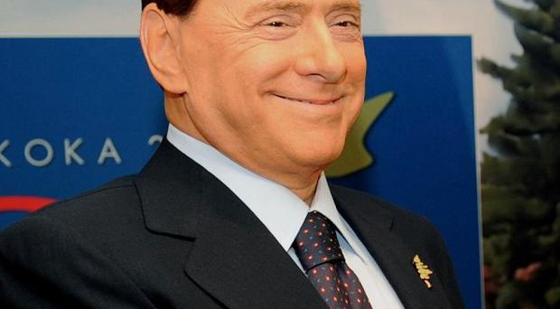 Italian Prime Minister Silvio Berlusconi rang a TV show discussing accusations he used prostitutes