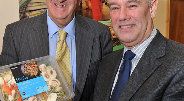 John McCann, Managing Director of Willowbrook Foods, Killinchy, shows Maynard Mawhinney, Invest IN's Food Director, the new products for Budgens in Britain.
