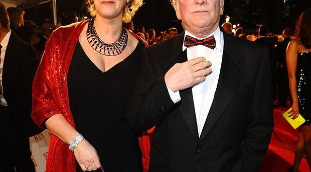 David Jason and his wife Gill arrive on the red carpet for the National Television Awards 2011