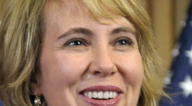 Gabrielle Giffords's condition has been upgraded from serious to good and she will be moved to a rehabilitation hospital (AP)