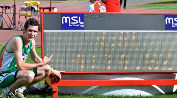 Michael McKillop points to the new world best he set for the T37 1500m at the Paralympics in New Zealand.