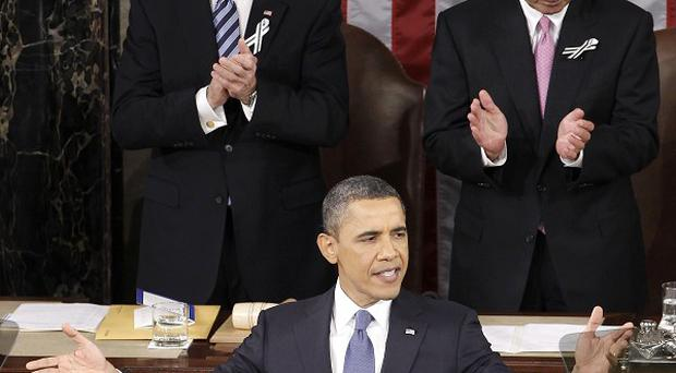 President Barack Obama gestures as he delivers his State of the Union address in Washington (AP)