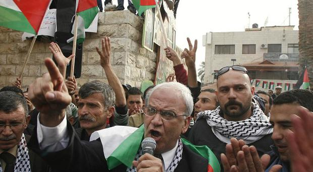 Senior Palestinian negotiator Saeb Erekat (centre) is surrounded by Fatah supporters during a rally in the West Bank town of Jericho (AP file photo)
