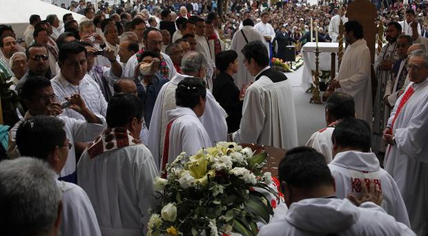 Priests carry the coffin of retired Bishop Samuel Ruiz into the cathedral in San Cristobal de las Casas, Mexico (AP)