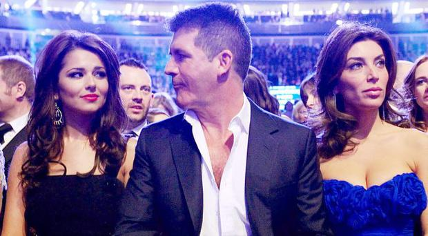 Cheryl Cole, Simon Cowell and Mezhgan Hussainy during the 2011 National Television Awards at the O2 Arena, London.