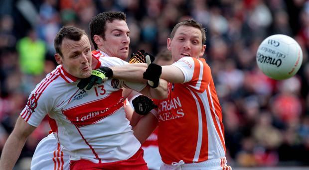 Derry's veteran forward Paddy Bradley (left) is hoping to shoot down Antrim, the team managed by his father Liam.