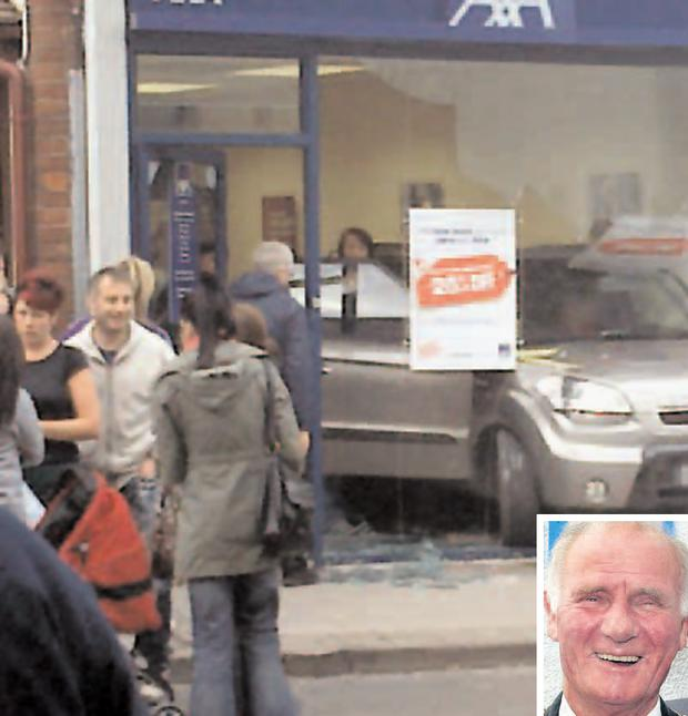 A car, surrounded by broken glass, sits in the front of the Axa Insurance shop on Larne Main Street after Bobby McKee (inset) crashed through the front window