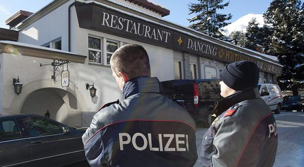 Policemen stand in front of the Posthotel Morosani, in Davos, Switzerland, after a small blast shattered two windows (AP)