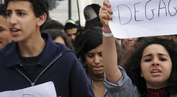 Students carrying posters demonstrate in Tunis (AP)