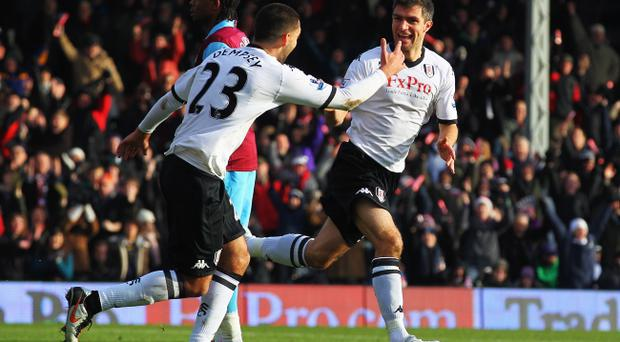 Northern Ireland defender Aaron Hughes is plotting a route to Wembley with Fulham under manager Mark Hughes.