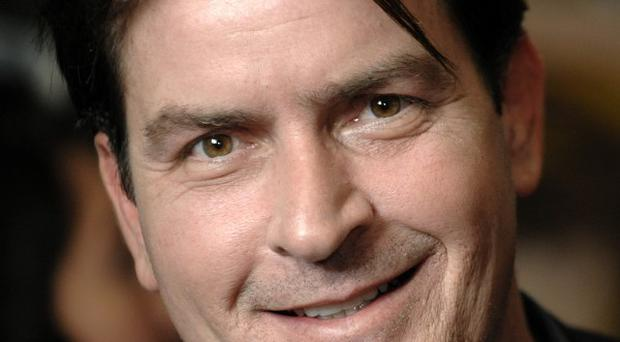 Charlie Sheen has been admitted to hospital with severe abdominal pains (AP)