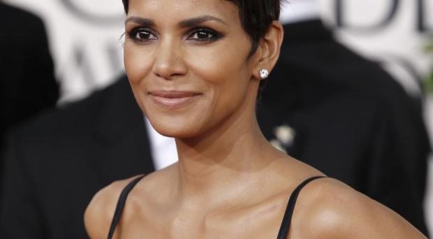 Halle Berry has said she can't play Aretha Franklin because she can't sing
