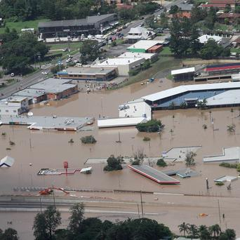An entire shopping mall is submerged outside Ipswich, west of Brisbane, Australia (AP)