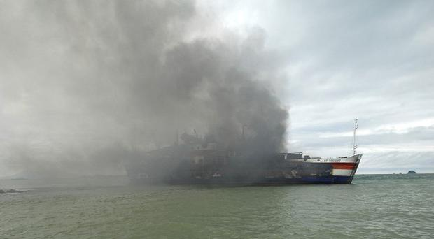 Smoke billows from a ferry that caught fire off Java island, Indonesia (AP)
