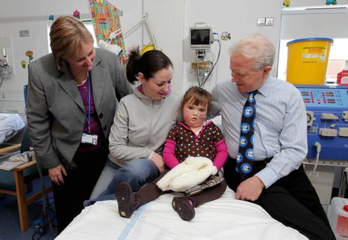 Sharon Fegan and daughter Catlin along with Dr Mary O'Connor and Professor Savage, members of the renal team at the Royal Victoria Hospital for Sick Children, which has been nominated in the Service with a Smile category.