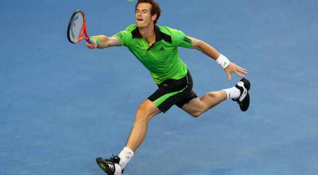 Andy Murray of Great Britain plays a forehand in his semi-final match against David Ferrer of Spain during day 12 of the 2011 Australian Open.