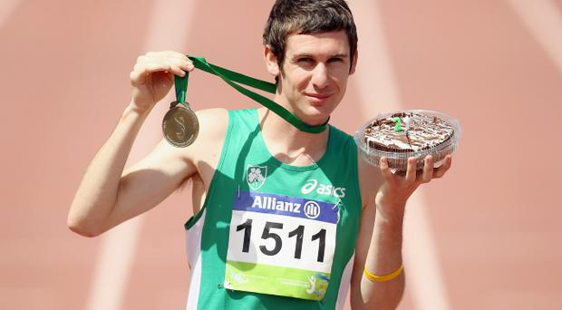 Newtonabbey man Michael McKillop with his gold medal.