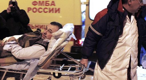 A wounded man is taken to hospital after a suicide bomber targeted Domodedovo airport in Moscow (AP)