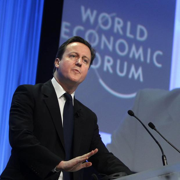 David Cameron defended cuts, stressing there are 'no short-cuts' to a stronger economy (AP)
