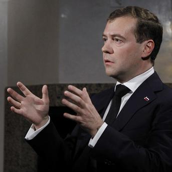 Russian President Dmitry Medvedev has signed the ratification of a nuclear arms cut pact backed by US President Barack Obama (AP)
