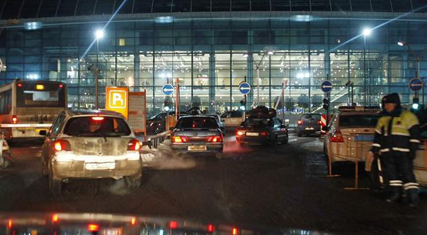 Russian investigators have identified a suicide bomber who killed 35 people and wounded 180 at Moscow's Domodedovo Airport (AP)