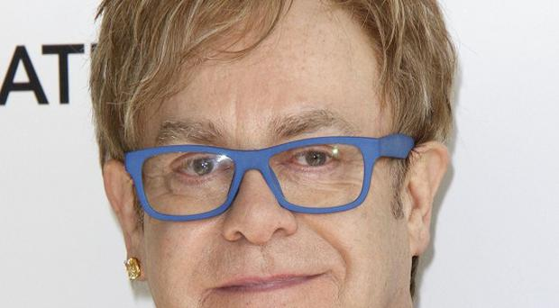 Sir Elton John apologised after swearing on air