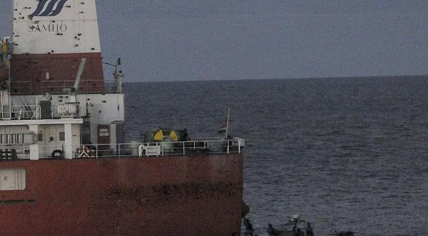 South Korean naval special forces approach the cargo ship Samho Jewelry in the Arabian Sea (AP)