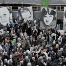 People gather for the 39th anniversary of Bloody Sunday in the Bogside area of Londonderry, for what is expected to be the last commemorative march following last year's Saville Report findings.
