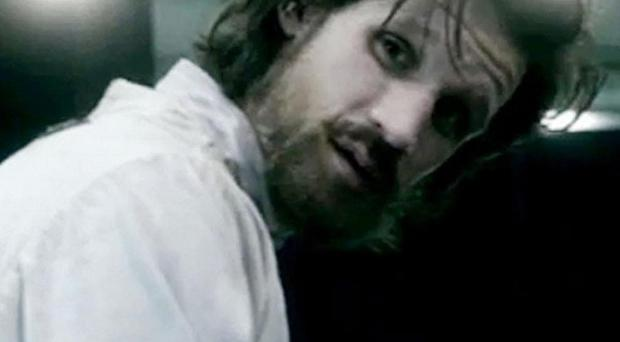 Dr Who actor Matt Smith sports a beard, shackles and a straitjacket in a forthcoming episode of Dr Who (BBC/PA)