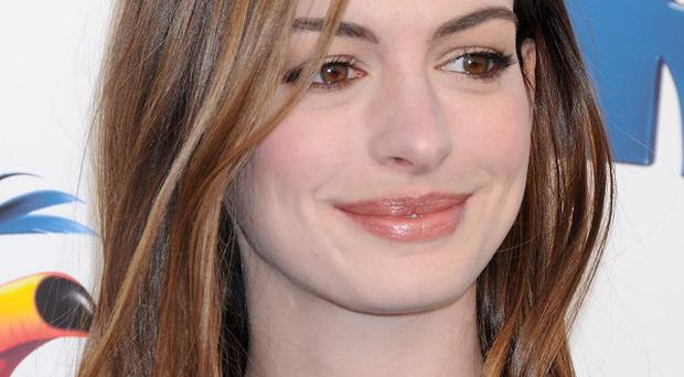 Anne Hathaway says singing in her latest movie was a surprise