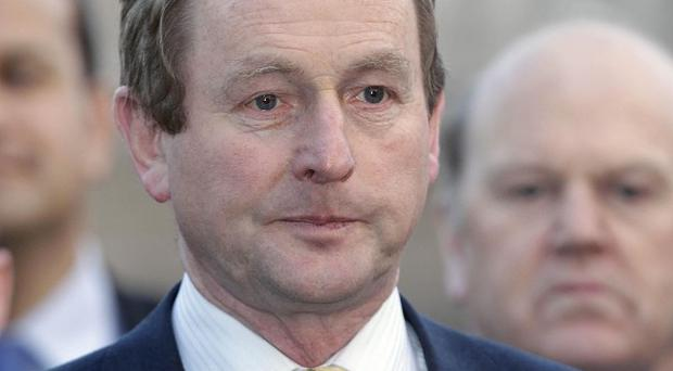 Fine Gael leader Enda Kenny has held talks with the European Commission president over Ireland's bailout package
