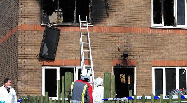 The scene of the house fire in Buxton, Derbyshire, in which two young children died