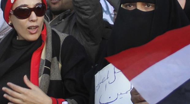 Women demonstrate in Tahrir Square, the central Cairo plaza that has become the protests' epicentre, in Cairo, Egypt