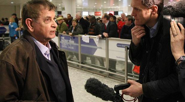 Passenger Ahmed Osman is interviewed by media after landing at Heathrow Airport on a flight from Cairo
