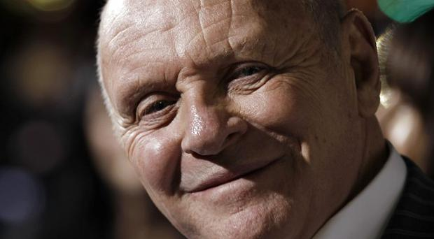 Sir Anthony Hopkins' new film The Rite has topped the US box office chart at the weekend