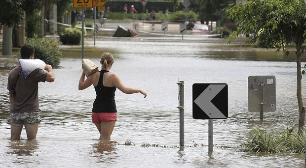 A strong tropical cyclone is heading towards flood-ravaged areas of Australia (AP)
