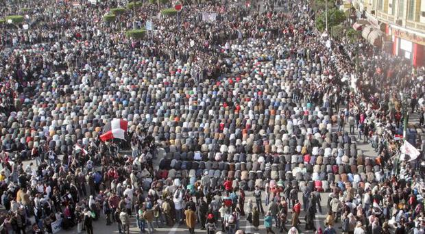 Muslims pray in Tarhir Square, Cairo, Egypt, as protesters gather calling for President Hosni Mubarak to stand down. Tuesday February 1, 2011.