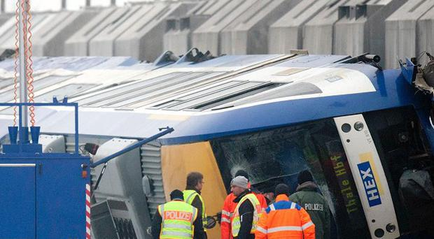 The driver of a cargo train involved in a fatal head-on collision is being investigated (AP)
