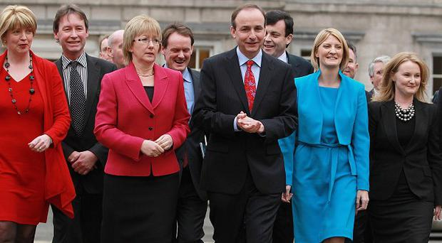 Fianna Fail leader Micheal Martin with his new front bench team on the plinth of Leinster House, Dublin