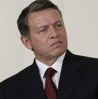 King Abdullah of Jordan has sacked his government in the wake of street protests (AP)
