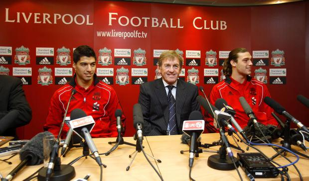 Luis Suarez (left) Kenny Dalglish (centre) and Andy Carroll during a Press Conference at Anfield, Liverpool.