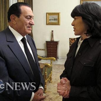 ABC News journalist Christiane Amanpour and Egyptian President Hosni Mubarak talk after an interview in Cairo