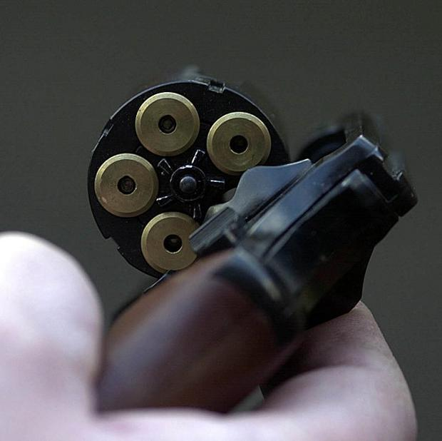 A man hid 63 pistols in his luggage on multiple trips to the UK, US court documents said