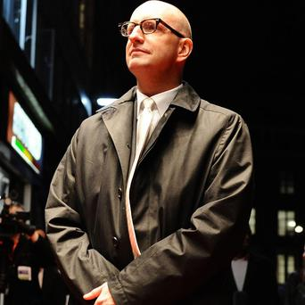 Steven Soderbergh has been hit with a paternity case