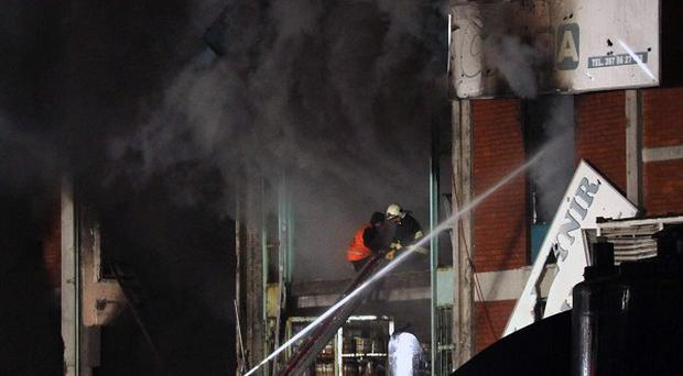 Rescue workers tackle a serious fire at an industrial estate in Ankara