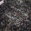 Demonstrators pray in Cairo's Tahrir Square (AP)