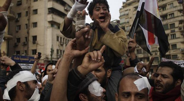 Anti-government protesters demonstrate in Cairo (AP)