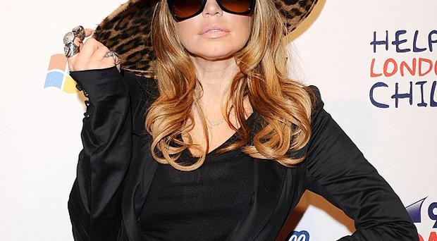 Fergie's exctied about the Black Eyed Peas slot at the Superbowl
