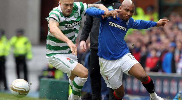 Rangers' El-Hadji Diouf challenges Celtic's Daniel Majstorovic during the Scottish Cup Fifth Round match at Ibrox Stadium, Glasgow.