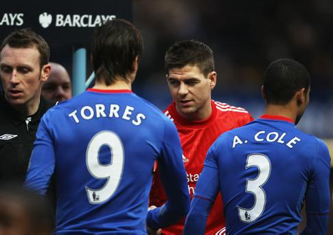 Fernando Torres of Chelsea shakes hands with former team mate Steven Gerrard of Liverpool prior to the Barclays Premier League match between Chelsea and Liverpool at Stamford Bridge on February 6, 2011 in London, England.